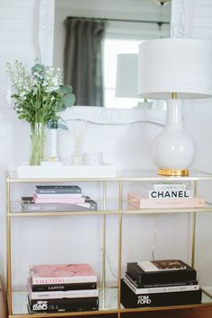 Chic glass + gold entry table: http://www.stylemepretty.com/living/2016/04/25/peek-inside-a-bloggers-glamorous-home-re-vamp/ | Photography: Angela Cox - http://www.angelacoxphotography.com/