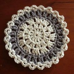 Simple, but pretty coaster. http://www.ravelry.com/patterns/library/contemporary-coaster