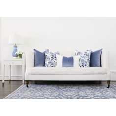 Moody and romantic, this dynamic floral was created with painterly strokes in shades of blue. Designed to pair with our plaids and velvets, this floral is sure to be the center of attention in any space.