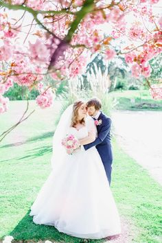 Bride and groom under cherry blossom three | pretty wedding portraits | fabmood.com #springwedding #weddingideas #springtime #portraits