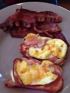 Bake egg, cheese, & maple bacon -  very easy & a huge hit!   I used square tins to make a larger portion.   Line bacon strips in muffin tin and then add whipped eggs with a shredded cheese ( about 3/4 full)  Bake @ 350 degrees for 35 min I put some bacon strips in a glass dish ( just sprayed with Pam) for the bacon lovers Cut up fruit while food is baking.