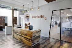 Boston - Norbella: Media agency Norbella's Boston headquarters—designed by ACTWO Architects—underline the company's clean, slick, professional approach with a classically neutral design theme. The predominantly wooden decor and floors are complimented by a white colour scheme that makes for an uncluttered and inspiring work environment.