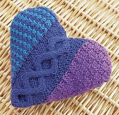 Free Knitting Pattern for Cables and Checks Heart Pillow - Heart-shaped cushion with a cable framed by basketweave and easy colorwork panels. Comes with matching afghan pattern. Designed by Patons