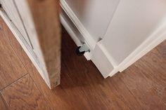 Sliding Door Tip... caster on baseboard behind sliding door so it won't bang the wall
