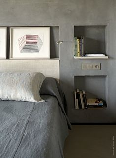 Concrete bedhead. Concrete Niches, Grey Bedding. Bedroom Artwork. Masculine Bedroom. Book Niches.
