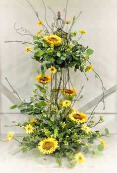 Sunflower Table Centerpiece - Designed by Kevin Roberts. Great for Barn Weddings and Country themed events. Goes well with Burlap accents.