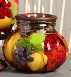 Distinctive Lifetime Oil Burning candles by White River Designs that capture nature's beauty for years to come. Colorful, bountiful fruit is sealed inside the glass decorative container with a separat