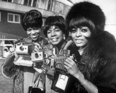 The Supremes with Polaroid Land Cameras.