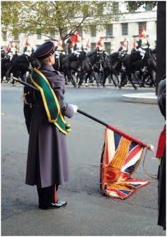 """Trailing the flag at a British Parade. Even today, a British military custom calls for troops to """"trail"""" their military unit's flag.  In this salute, the staff or pike on which the flag is mounted is swung down so the flag drags on the ground before the sovereign.  Is this a sign of disrespect?  No just courtesy to the monarch."""