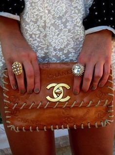 Love everything about this pic. The lace dress, rings and chanel clutch!!!