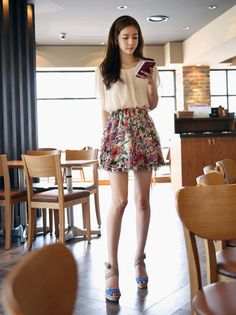 Casual, korean: White, chiffon blouse. White, high waist, a-line skirt with flower pattern. Blue shoes with heels.