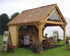 Cheshire Oak Structures Ltd, based in Church Road, Malpas, Cheshire. Specialising in Green Oak Carports, Green Oak Framed Garages And Oak Framed Buildings. Outdoor Rooms, Outdoor Living, Outdoor Kitchens, Design Barbecue, Storing Garden Tools, Garden Huts, Bbq Hut, Cedar Roof, Wood