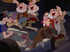 The dwarfs cheering for Snow White's decision to stay