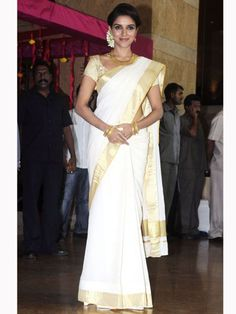 Asin: Asin looks pretty in a south Indian white sari with gold border.