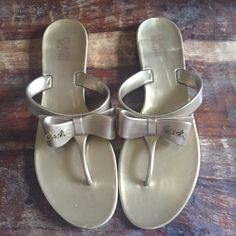 Coach jelly sandals. Super cute gold jelly flip flops. New and never worn. Coach Shoes Sandals