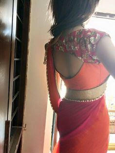 Designer blouse in pink and orange teamed with shaded chiffon Saree