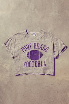16 Vintage Tees To Live In All Summer #refinery29  http://www.refinery29.com/vintage-t-shirts#slide16  Russell Athletic Vintage Fort Bragg Crop Tee, $108, available at Free People.