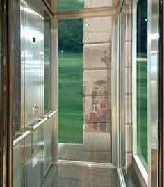 Exterior glass lift or elevator is a nice way to get down for Houses with elevators for sale