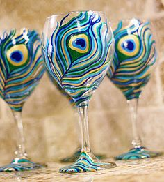 Hand painted peacock wine glass by http://myliquidtherapy.com