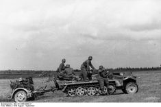 """Half tracked vehicle (Halbkettenfahrzeug) towing a rocket launcher Nebelwerfer during the Battle of Smolensk during Aug-Sept 1943. The Nebelwerfer was a dependable weapon used widely by the German infantry as a """"force multiplier"""" especially when attacking prepared positions and/or concentrations of enemy infantry."""