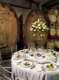 These wine barrels add a dramatic touch to an already stunning tablescape! {Crooked Vine Winery}