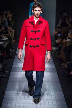This red coat look was our favorite from the Gucci collection, that otherwise was quite strange and conservative, chromatically speaking.  See the best looks from the Milan Fashion Week Fall-Winter 2015-16 menswear collections:  http://attireclub.org/2015/01/22/milan-fashion-week-fall-winter-2015-16-menswear-collections-review/  #Milan #MFW #menswear #mensfashion