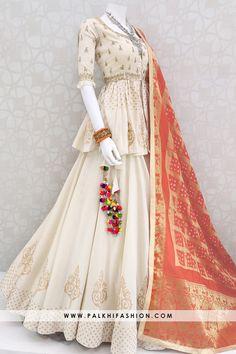 Beige premium khadi silk full flair chaniya choli with peplum crop top enriched with silk embroidery & mirror work. Party Wear Indian Dresses, Designer Party Wear Dresses, Indian Gowns Dresses, Indian Bridal Outfits, Indian Fashion Dresses, Dress Indian Style, Indian Designer Outfits, Stylish Dresses For Girls, Stylish Dress Designs