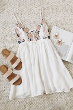 Theres no need to pick petals, were certain of our love for the Lulus Daisy Petal Pickin Ivory Embroidered Dress! Adjustable straps support a scalloped triangle bodice decorated with lovely beige, blush, and blue floral embroidery. Flirty woven skirt flares below a fitted waist. #lovelulus