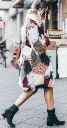 Jacqueline Mikuta is not afraid to stand out in this utterly unique patchwork coat from Asos! Try wearing something similar with heeled ankle boots to recreate this awesome look.   Faux fur: Asos, Dress: Bershka, Boots: Circus by Sam Edelman, Bag: Ganni.