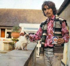 George Harrison in good company with his blue point Siamese cat.