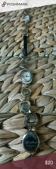 Brighton silver and gold heart watch This pretty watch has hearts that spin from silver to gold tone.  The watch shows some wear but is in really good condition, it just needs a new battery.. Brighton   Accessories Watches