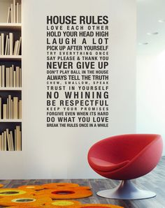 House rules. Love the decal, but also the embedded library + the red chair :)