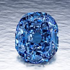 "The Wittelsbach Diamond started as a fancy deep grayish blue diamond weighing in at 35.56 carats. Origins unknown, the diamond ""appeared"" in 1962 and was determined to be of Indian origin. Passing from one royal family to another, it was eventually sold at auction in 2008 for $23.4 million to London-based jeweler Laurence Graff. Graff then recut the stone, revising it to a Internal Flawless 31.06 carats Fancy Deep Blue Diamond. The biggest blue diamond in the world."