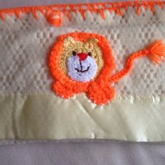 Up cycling.  Cut a larger blanket into baby cot size pieces: crocheted the appliquéd the lion and blanket stitched all around