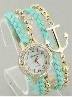 """Make time fashionable by putting on this gorgeous Crystal Anchor Watch! Featuring a shiny gold rim face plate, anchor chain, gold time markers and hands.  Please click on our tab """"Watches"""" to view additional colors available."""