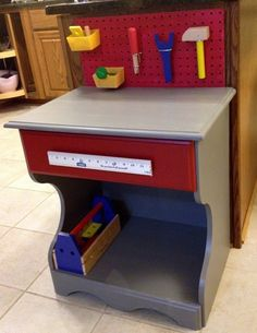 Upcycled child's tool bench from an old night stand
