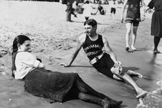 A bathing suit-clad woman and Nikola Tesla (swimming instructor) pictured on Midland Beach, Staten Island, N., Wow, to have Tesla for instructor &