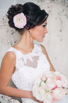 black wedding hairstyle updo with pink flower