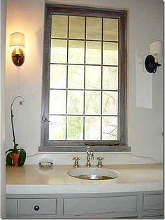 Bathroom: sink & window & sconce
