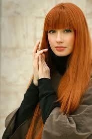nice that a red head can wear orange lipstick-I like it!