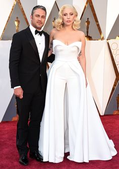1dc1517bdac8 Could Lady Gaga   Taylor Kinney Be Any Cuter at the Oscars ! Taylor Kinney Celebrity CouplesCelebrity DressesCelebrity StyleHot CouplesWhite  JumpsuitWhite ...