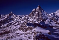 Matterhorn and Alps - A different view of the classic Matterhorn sitting at 4,478 metres (14,692 ft).  This perspective is taken 7km away while sitting on the summit of the Klein Matterhorn (Little Matterhorn) at 3,883 metres (12,740 ft).   The Klein Matterhorn sits in the Pennine Alps and overlooks Zermatt in the Swiss canton of Valais.   The Matterhorn is the straddling the main watershed and border between Switzerland and Italy with Italy to the left of frame and Switzerland right of…