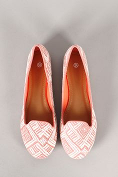 Complement your laid-back style with these cute loafer flats! Featuring a tribal print canvas throughout, round toe, piping detail, lightly padded insole, and easy slip on style.