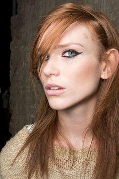 Clumped lashes and cat eyeliner at Simonetta Ravizza Fall 2014 #MilanFashionWeek #MFW