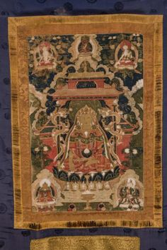 Arte Himalayana.  A thangka depicting Buddha Shakyamuni Tibet, 19th century . Tempera painting on cotton portraying the historical Buddha in an uncommon way. The character is portrayed in a pagoda, with dragons wrapped on the pillars. He is sitting in the padmasana position on a throne shaped like a lotus flower, and holds in the left hand, resting in the avakasamudra, the bowl for the offerings, while the right hand performs the bhumisparsamudra. The peculiarity of the representation lies…