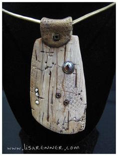 """Lisa Renner's faux ivory polymer clay pendant has an intriguing ancient look, thanks to the many """"imperfect"""" details of cracks, gouges and wear, as seen on The Polymer Arts blog, http://www.thepolymerarts.com/blog/9488"""