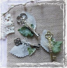 This handsome skeleton key boutonniere is perfect for vintage style weddings. So handsome, and loaded with old fashioned charm. Each key is decorated with a touch of baby's breath, a linen leaf, a silk ivy leaf, and a simple wrap. It makes a lovely statement on a gentleman's lapel.I have an assortment of keys, so each boutonniere is unique. Please see a sample of the variety in the first photo. It attaches with a pin, which is included. These are actual, full-size, skeleton keys...