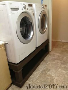 diy laundry pedestal, cleaning tips, diy, laundry rooms, storage ideas, woodworking projects, Once all of the paint was dry we moved it into the laundry room and lifted our washer and dryer on top The washer was pretty heavy but my husband and I managed just fine
