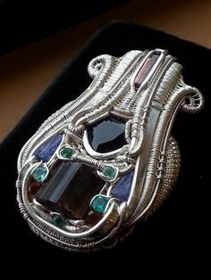 ©Andrew Steves #wirewrap #jewelry #wirewrapjewelry