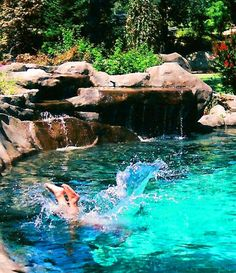 Natural Stone Swimming Pool Waterfalls Help Make Design Holes The Centerpiece Of